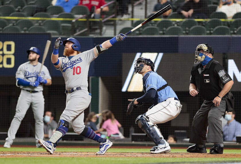 Justin Turner follows through on a flyout in Game 5 of the World Series in Arlington, Texas, on Oct. 25.