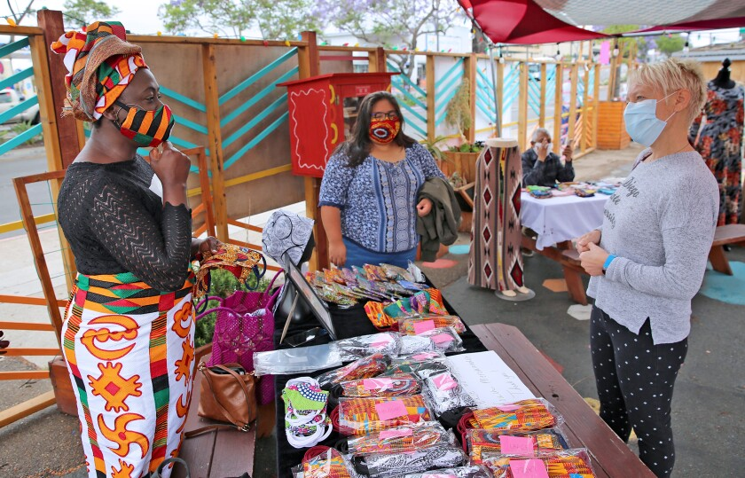 The El Cajon Boulevard BIA hosted a face mask fashion show in June to showcase local refugee designers.