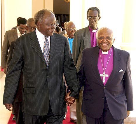 Kenyan President Mwai Kibaki, left, walks with visiting South African Bishop Desmond Tutu at State House, the presidential residence in Nairobi, where they discussed the postelection violence that has racked the country.