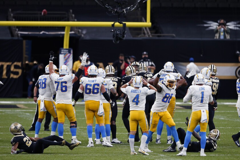 Chargers kicker Michael Badgley (4) reacts after missing late field goal Monday that would have won game.