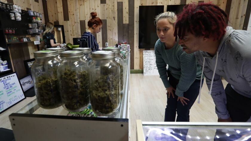 Olivia Juliano, left, and Morgan Nettles at Greenlight Discount Pharmacy, a marijuana shop in Sylmar, in April.