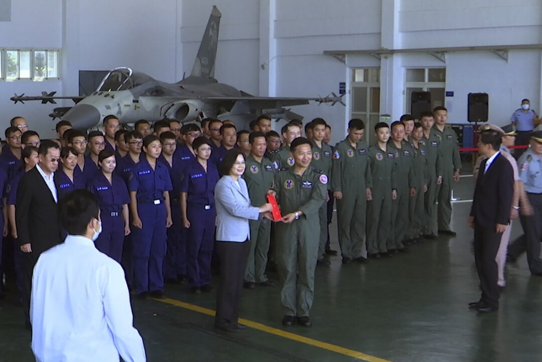 Taiwan President Tsai Ing-wen, center left, has been working to promote military service.