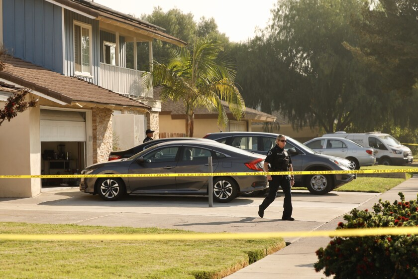 Placentia street is blocked by police tape during investigation of triple homicide