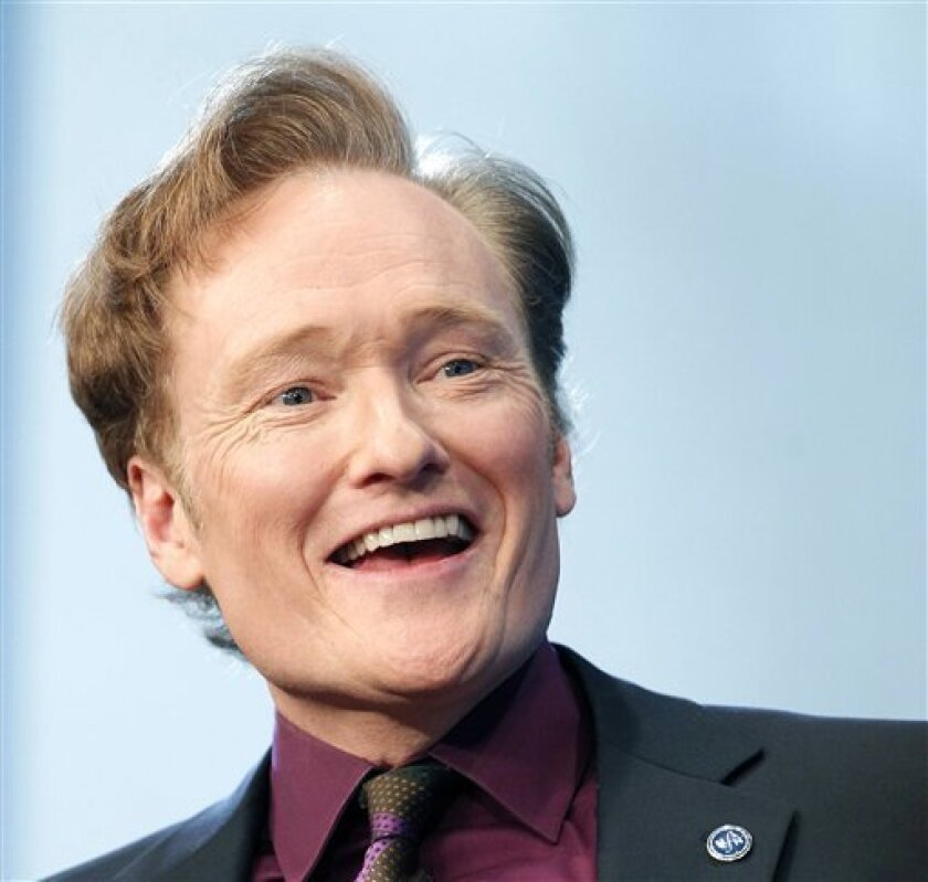 FILE - In this May 24, 2012 file photo, comedian Conan O'Brien speaks at the John F. Kennedy Presidential Library in Boston. O'Brien will be spending a late night with President Barack Obama. The White House Correspondents' Association has chosen O'Brien as the featured act for its annual dinner on