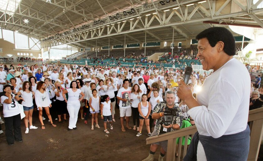 """Chubby Checker speaks to the crowd at the Del Mar Arena at the San Diego County Fair prior to the attempt to break the world record of people doing the """"Twist."""""""