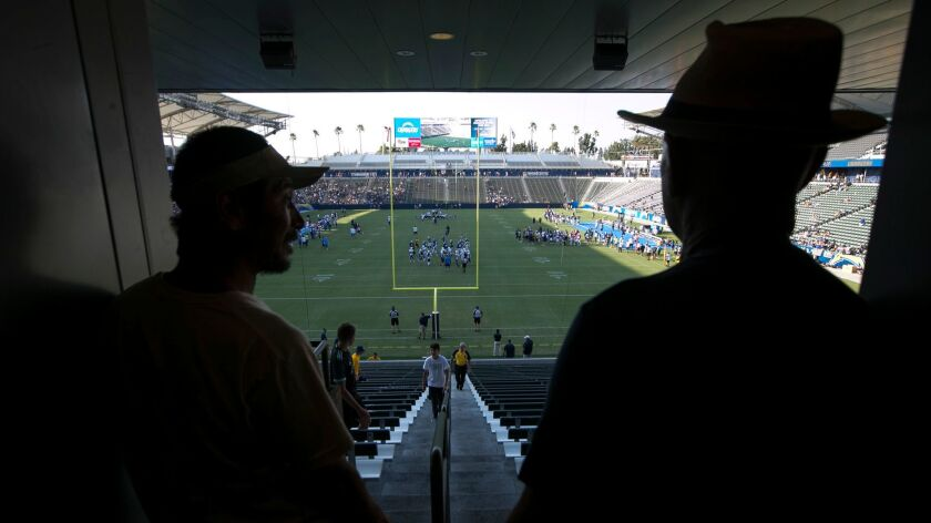 Fans watch from the South side of the stadium as the Chargers and Rams conduct a joint practice.