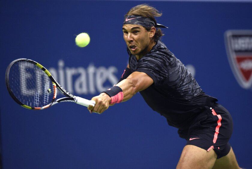 Rafael Nadal hits a return against Fabio Fognini during the U.S. Open on Friday.