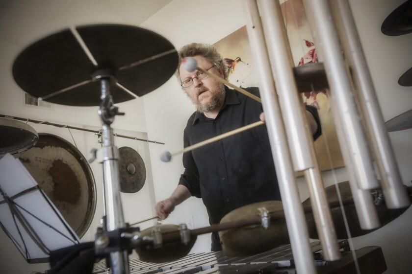 Percussionist Nathan Hubbard plays at his San Carlos home.