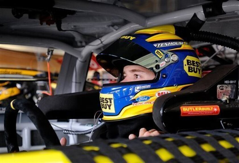 Pole sitter Ricky Stenhouse Jr. straps into his car during practice for Sunday's NASCAR Sprint Cup Series auto race at Atlanta Motor Speedway, Saturday, Aug. 31, 2013 in Hampton, Ga. (AP Photo/David Tulis)