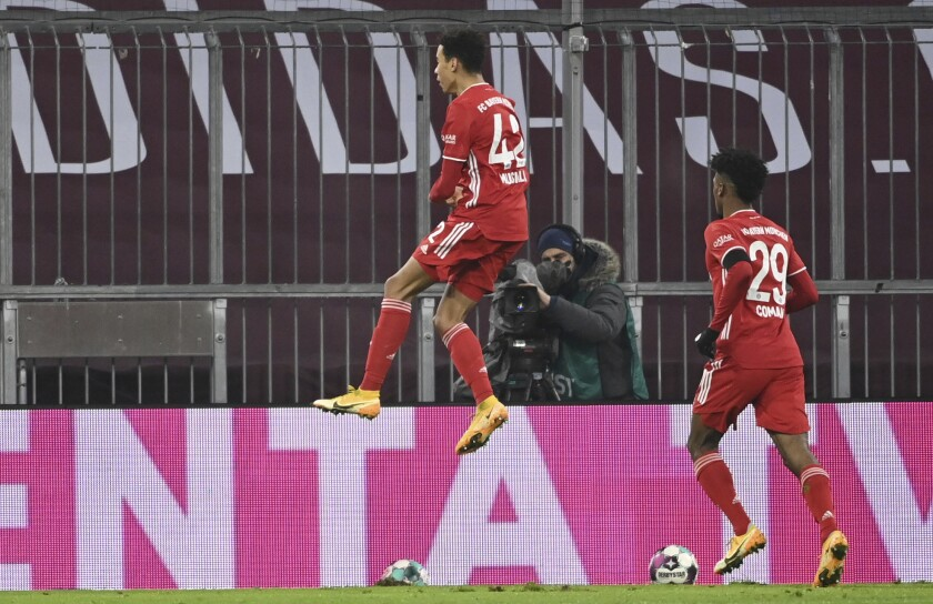 Bayern's Jamal Musiala celebrates his goal during a German Bundesliga soccer match between Bayern Munich and RB Leipzig in Munich, Germany, Saturday, Dec. 5, 2020. (Sven Hoppe/dpa via AP)