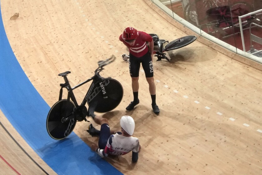 Frederik Madsen of Team Denmark and Charlie Tanfield of Team Britain (133) get up after crashing during the track cycling men's team pursuit at the 2020 Summer Olympics, Tuesday, Aug. 3, 2021, in Izu, Japan. (AP Photo/Christophe Ena)