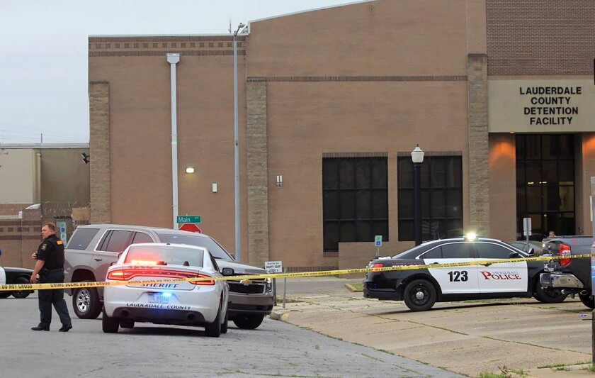 Police block off streets following the shooting of Lauderdale County Chancery Court Judge Charles Smith outside the Lauderdale County Courthouse, in Meridian, Miss., on Monday, March 16, 2020. Smith was shot and critically wounded in the parking lot outside the courthouse. (Dave Bohrer/The Meridian Star via AP)