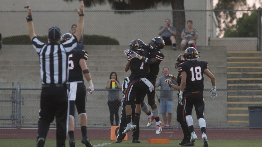 From right, Huntington Beach's Arick McLawyer celebrates with Isaac Bryant after scoring against Can