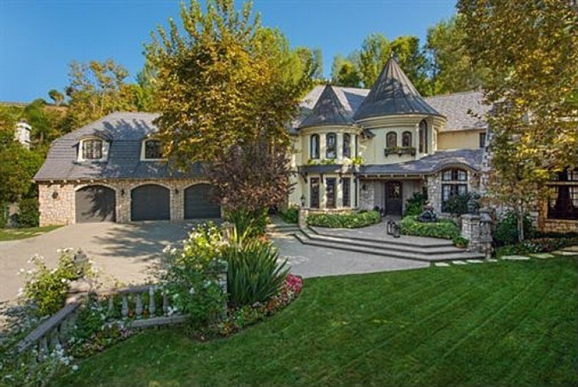 Joe and Tina Simpson sell Encino house