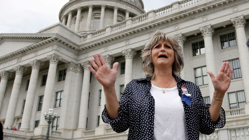 "Jeanette Finicum, the widow of Robert ""LaVoy"" Finicum, speaks with reporters during a rally on March 5, 2016, at the Utah State Capitol, in Salt Lake City."