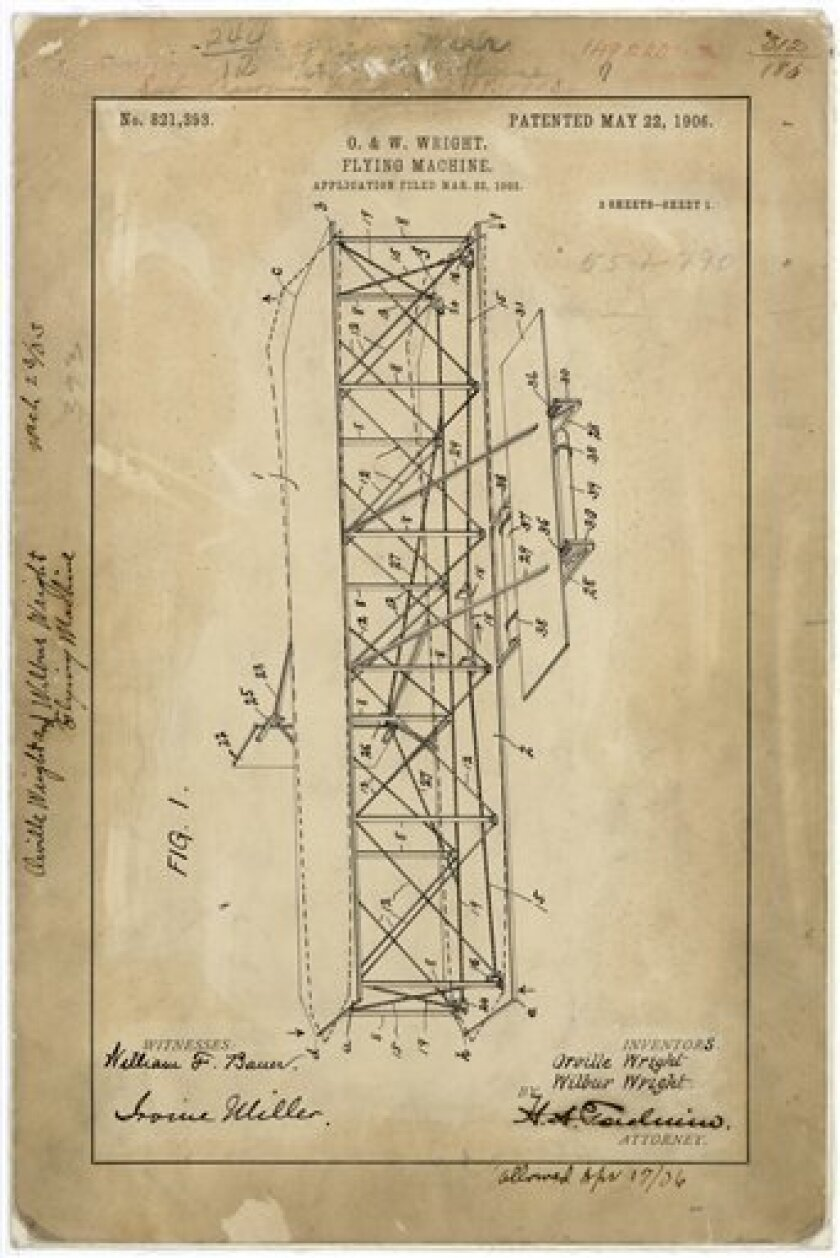 This image provided by the National Archives and Records Administration (NARA) shows the first of the three-page patent application #821,393, dated May 21, 1903, submitted by Orville and Wilbur Wright to the U.S. Patent Office for their Flying Machine. This and many other historical items that that the Archives once possessed are missing; some were stolen by researchers or rogue Archives employees; others simply disappeared without a trace. (AP Photo/U.S National Archives Records Administration)