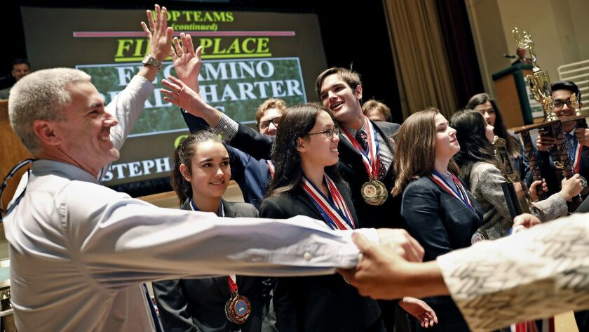El Camino Real Charter High School students celebrate with Principal David Hussey, left, after winning L.A. Unified's Academic Decathlon competition in February.