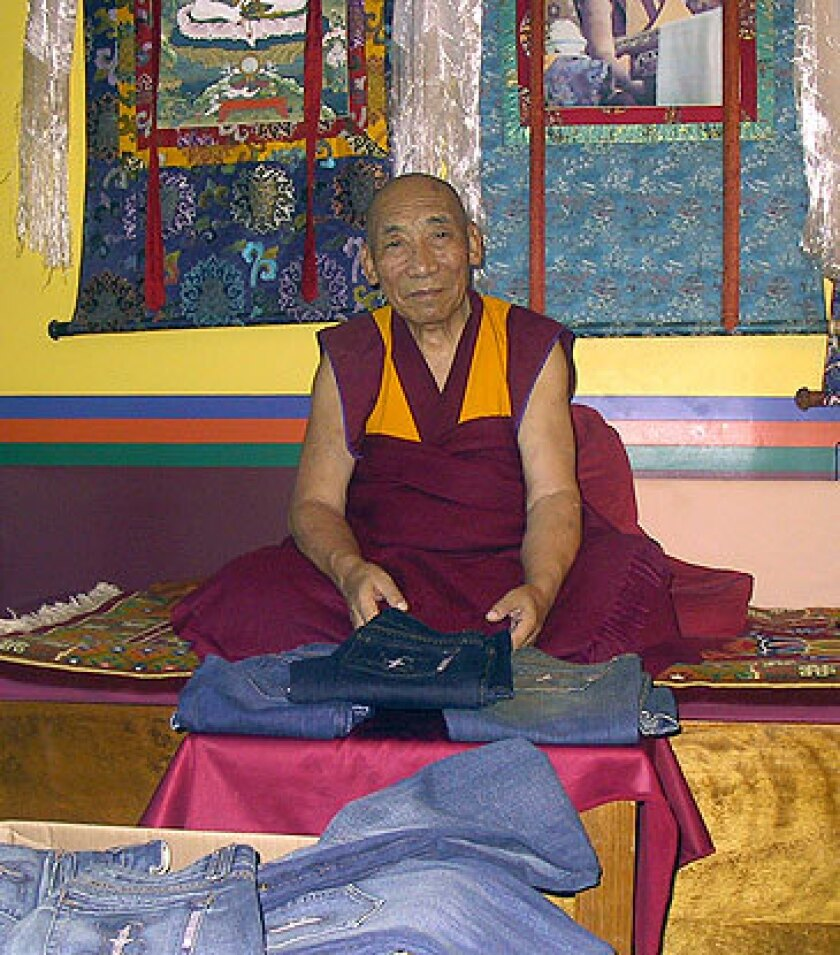 With wishes for good karma, Tibetan monk Geshe Gyeltsen chants over every 35th Street pair.
