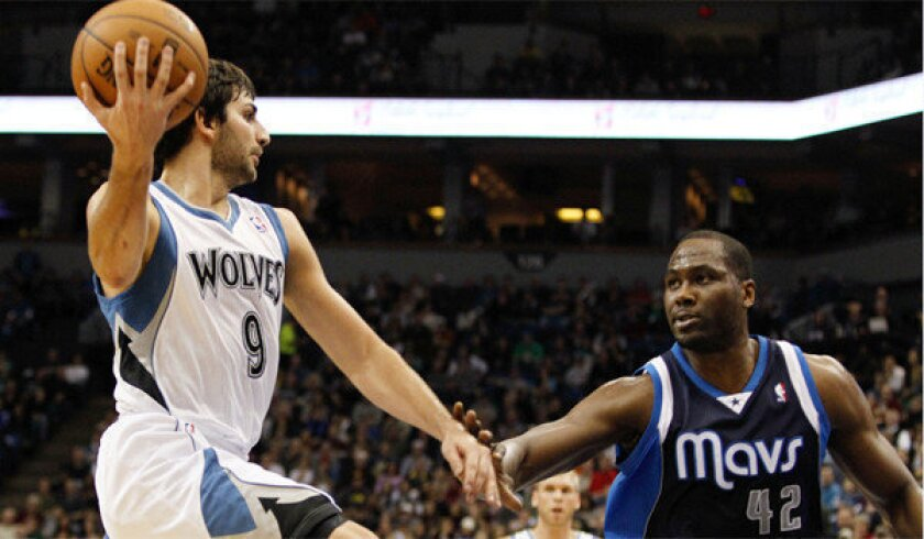 Minnesota's Ricky Rubio tries to pass the ball around Dallas' Elton Brand; a Lakers sweep of the Timberwolves would be a major step toward moving up a spot in the standings.