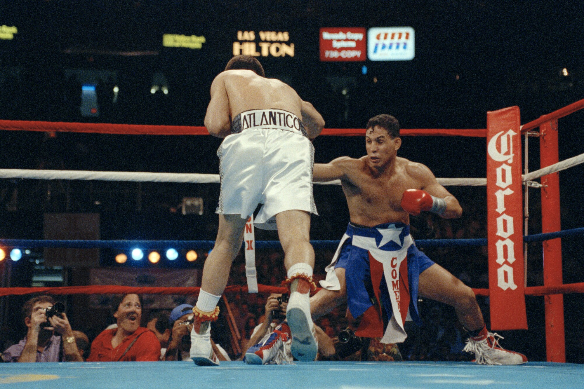 Challenger Hector Camacho gets down low in the corner while trying to avoid the charge of champion Julio Cesar Chavez.