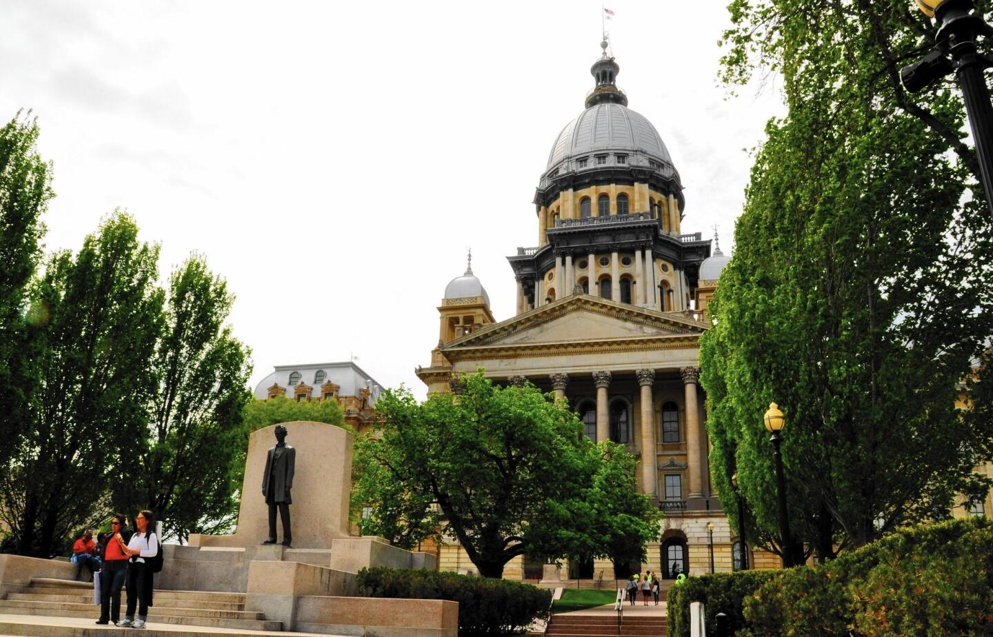 The Illinois State Capitol pays homage to Abraham Lincoln with statues inside and outside the building.