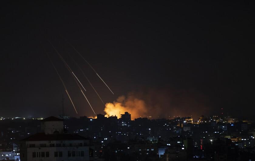 Smoke rises over Gaza City at night.