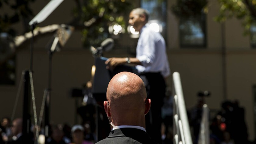 A Secret Service agent watches as President Obama speaks at Los Angeles Trade Technical College in July. A man in the audience yelled that Obama was the Antichrist.