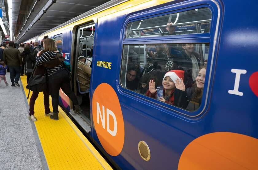 Children peer though a train window at the newly opened 86th Street station on the Second Avenue subway in New York.