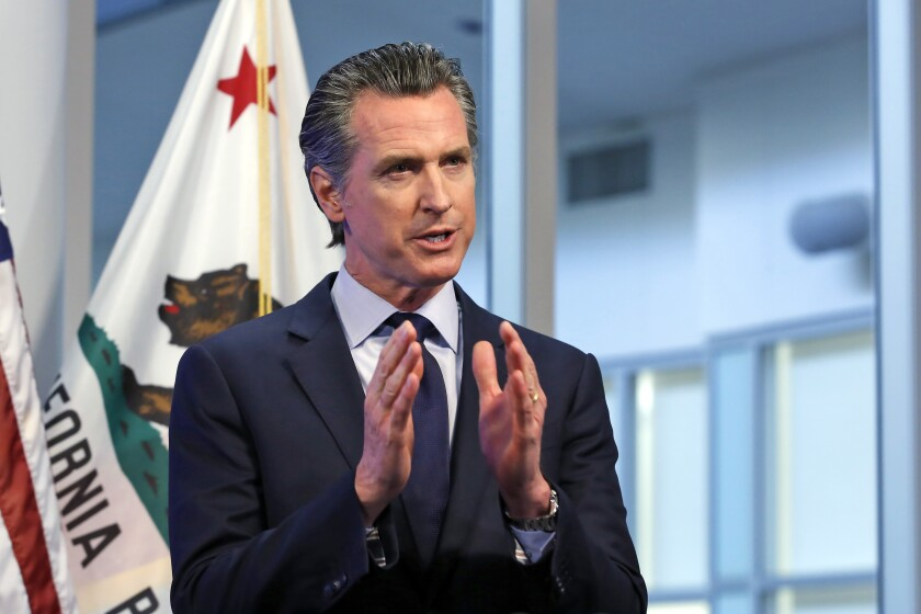 California Gov. Gavin Newsom discusses at an April 14 news conference an outline for what it will take to lift coronavirus restrictions.