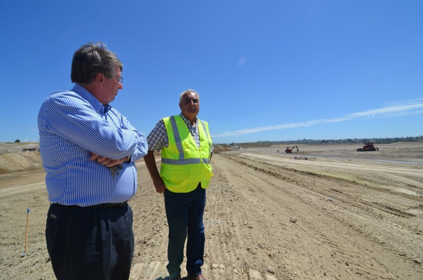Oceanside Councilman Jerry Kern and Moody's general manager Jerry Perrault discuss progress on the sports fields at El Corazon on Tuesday.
