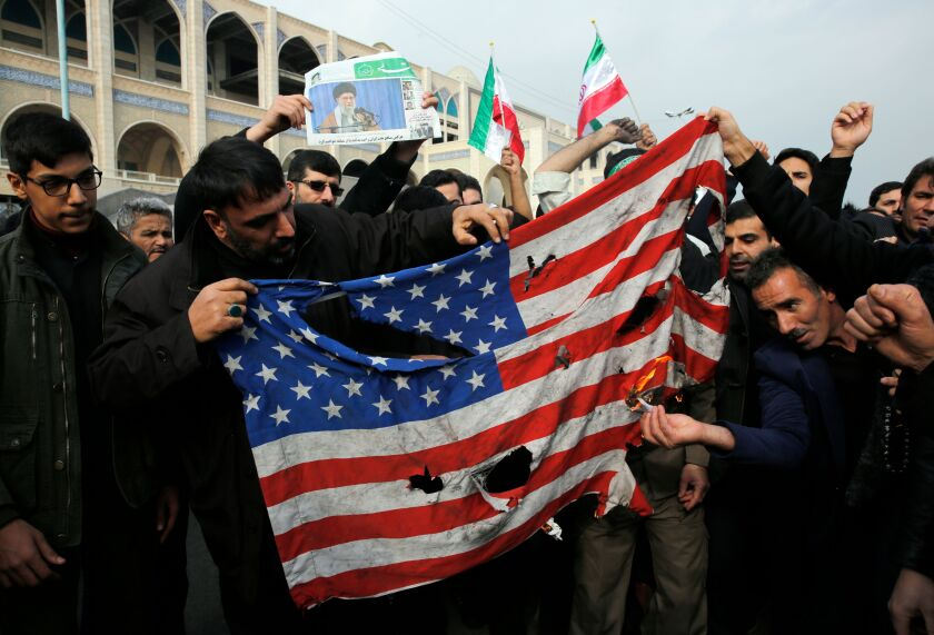 Iranians burn a U.S. flag Jan. 17 in Tehran after Friday prayers.