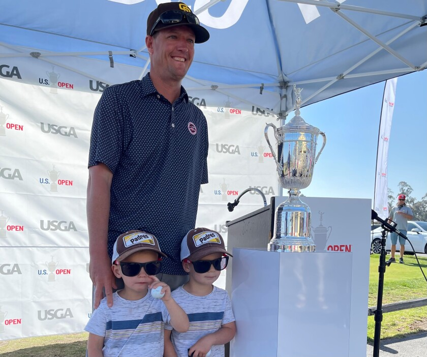Grant Strobel poses with U.S. Open trophy at Balboa Park Golf Course along with his 3-year-old twins, Jack (left) and Ben.
