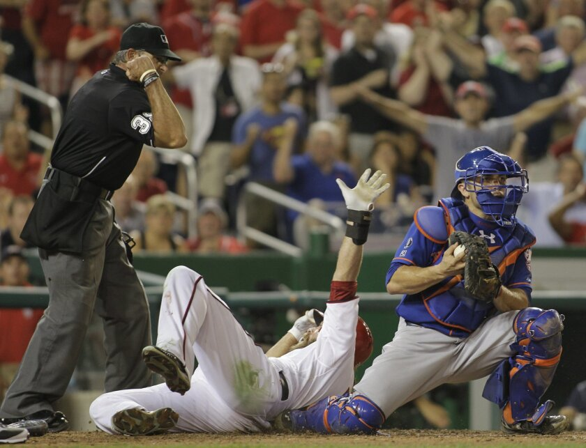 Washington Nationals' Jayson Werth, center, is called out at home plate as New York Mets catcher Travis d'Arnaud, right, looks to first base during the sixth inning of a baseball game, Tuesday, Aug. 5, 2014, in Washington. The Mets won 6-1. (AP Photo/Luis M. Alvarez)