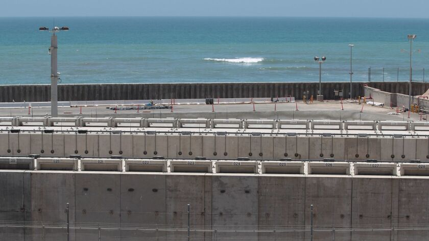 Some of the 3.55 million pounds of spent fuel at the San Onofre Nuclear Generating Station rests in dry cask storage within sight of the Pacific Ocean. From a 2016 file photo.