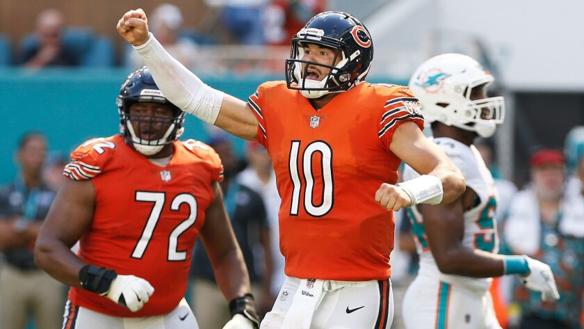 Mitchell Trubisky (10) of the Chicago Bears celebrates after throwing a touchdown pass to Allen Robinson (12) in the third quarter against the Miami Dolphins at Hard Rock Stadium on October 14, 2018 in Miami, Florida.