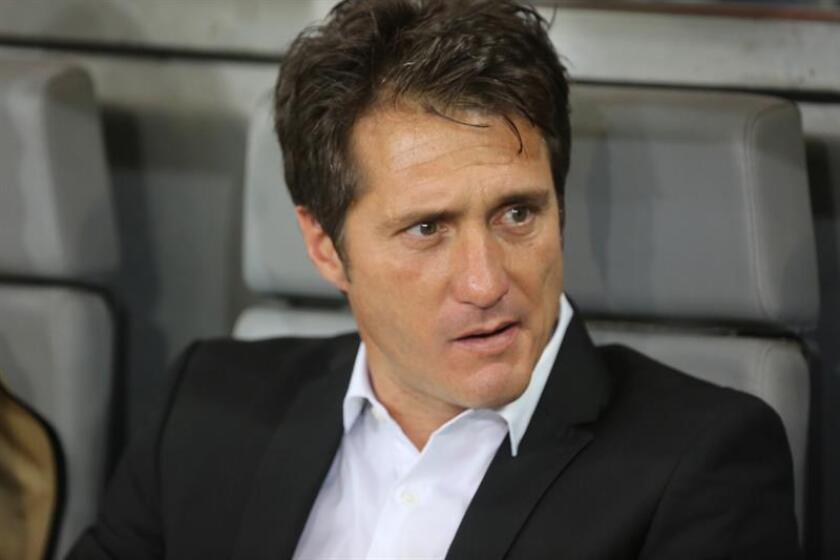The manager of Buenos Aires club Boca Juniors, Guillermo Barros Schelotto, watches from the sidelines during a Copa Libertadores quarter-final match against Brazilian club Cruzeiro on Oct. 4, 2018, in Belo Horizonte, Brazil. EPA-EFE/Paulo Fonseca