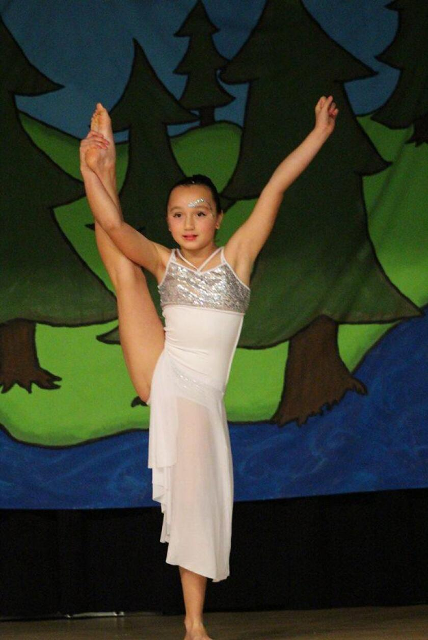 Third grader Callie W. dances in front of a packed house at Barnard Elementary's recent talent show.