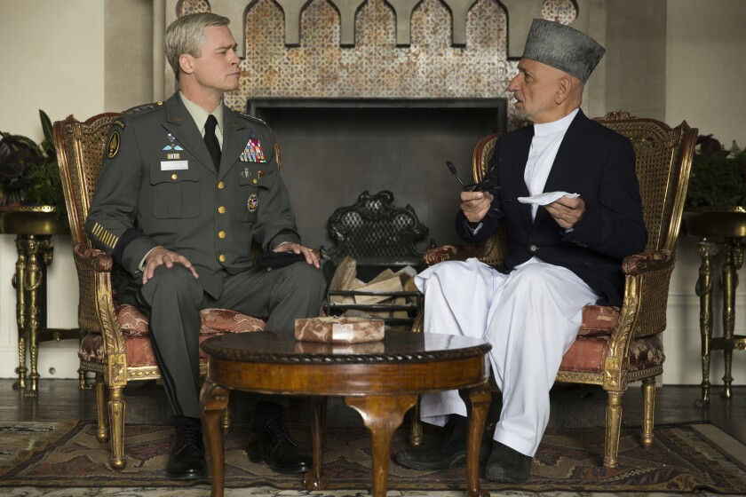 "Brad Pitt as Gen. Glen McMahon and Ben Kingsley as President Karzai in the film ""War Machine."""