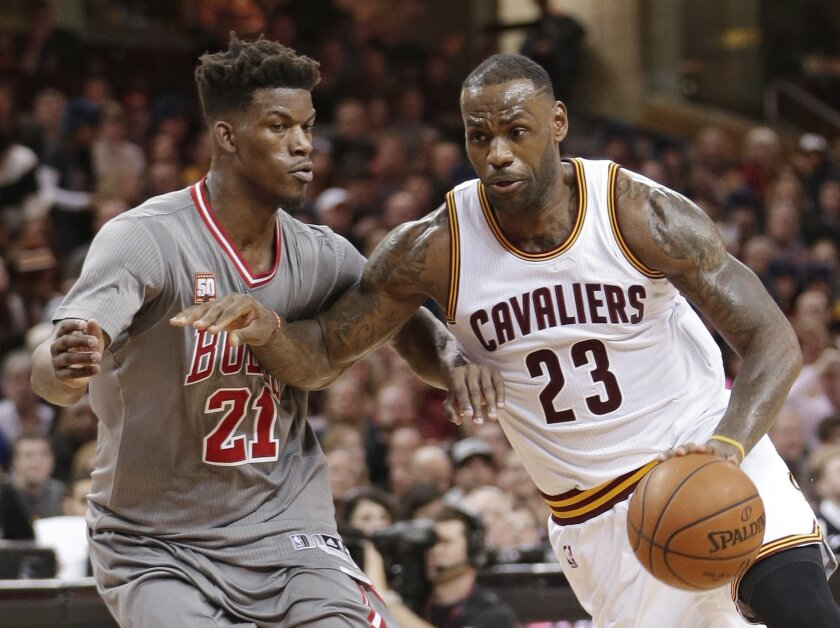 Cleveland Cavaliers' LeBron James (23) drives past Chicago Bulls' Jimmy Butler (21) in the second half of an NBA basketball game Saturday, Jan. 23, 2016, in Cleveland. The Bulls won 96-83. (AP Photo/Tony Dejak)