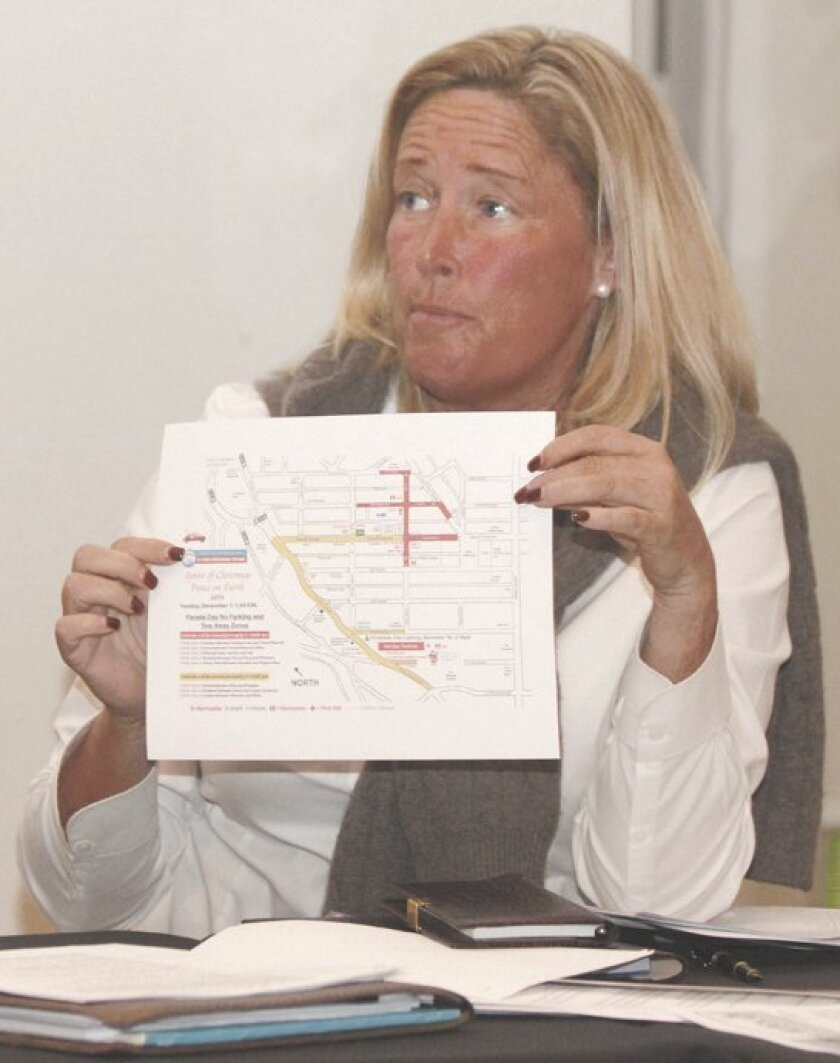 """Planning Association trustee Cindy Greatrex displays a map of the La Jolla Christmas Parade that she said San Diego Police use as a model for other civic gatherings throughout the city. """"If we're sticking to (a discussion of) street closures, I cannot come up with a reason why we would not pass thi"""