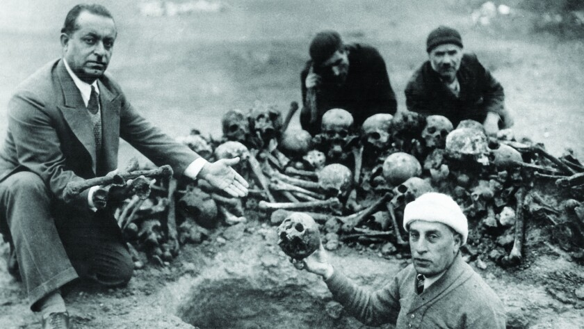 """Archaeologists excavate Armenian dead from mass graves, from the documentary """"Intent to Destroy."""""""