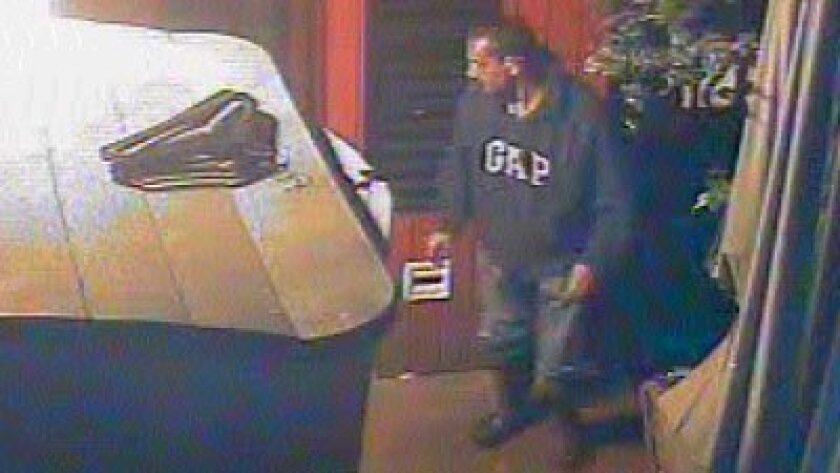 A still from video footage of a suspected robber who broke into Barbarella restaurant in the Shores early July 12.