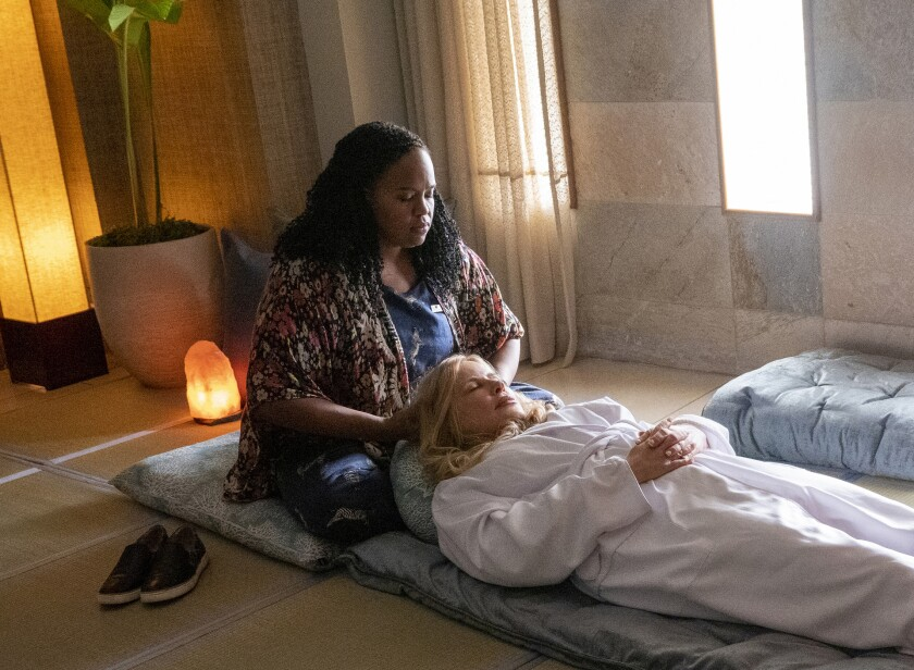 """Natasha Rothwell and Jennifer Coolidge are shown in a scene from """"The White Lotus."""""""