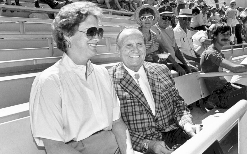 Angels owner Gene Autry sits alongside his wife, Jackie, during a 1984 spring training game in Palm Springs.