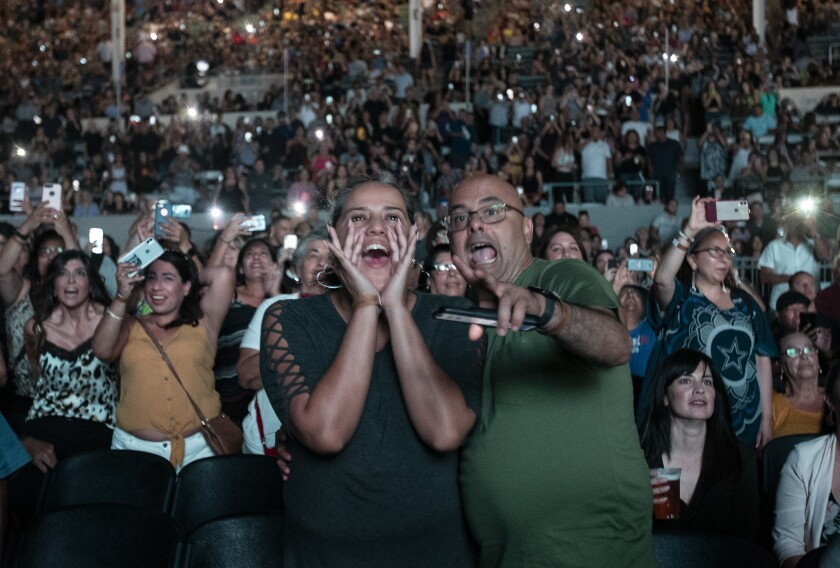 Fans react to a performance by Latin Grammy winner Pitbull at the L.A. County Fair earlier this month.