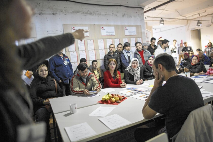 Refugees from different countries attend an information session in Berlin in late February.