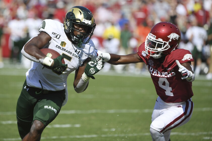 Colorado State running back Marvin Kinsey Jr. tries to run past Arkansas defender Jarques McClellion during a game last month. Kinsey is averaging 125 yards a game rushing for the Rams.