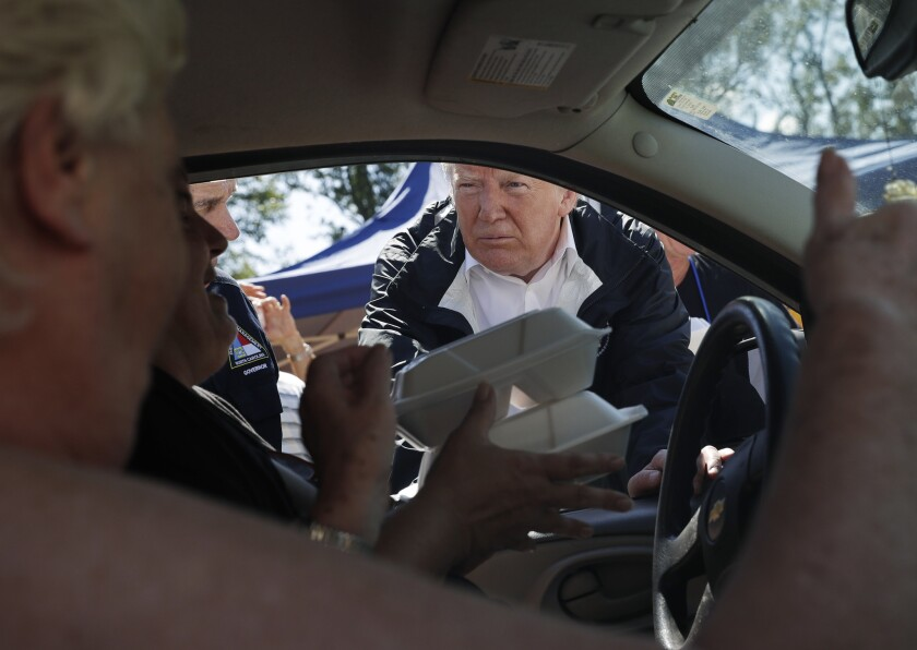President Trump hands out food at Temple Baptist Church in New Bern, N.C., on Wednesday.