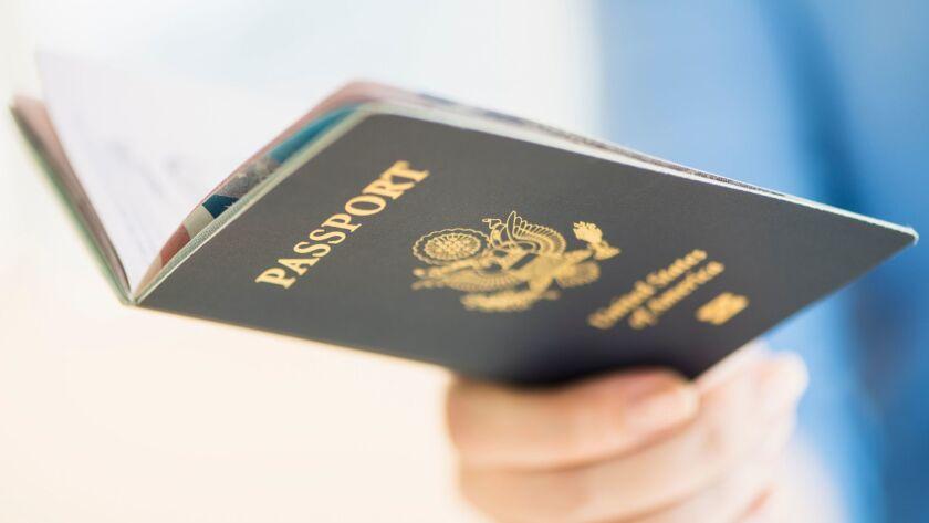 A woman holds her U.S. passport.