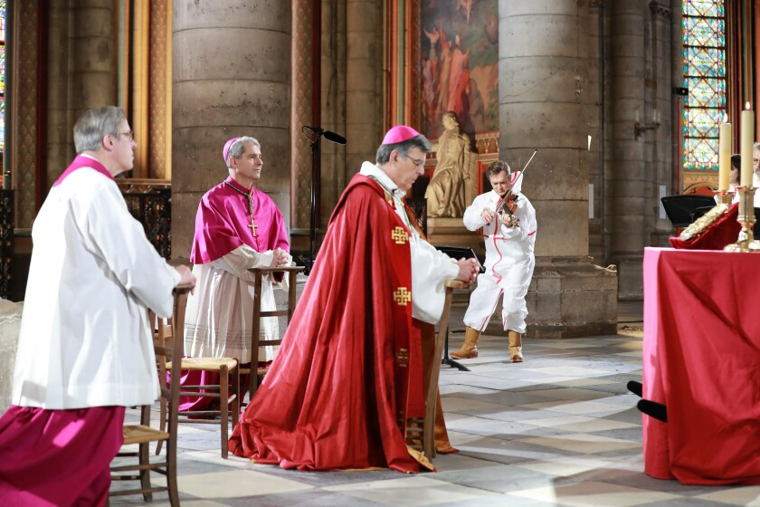 Notre Dame Cathedral rector Patrick Chauvet, from left, Auxiliary Bishop of Paris Denis Jachiet and Archbishop of Paris Michel Aupetit hold a Good Friday ceremony, which was televised but closed to the public.